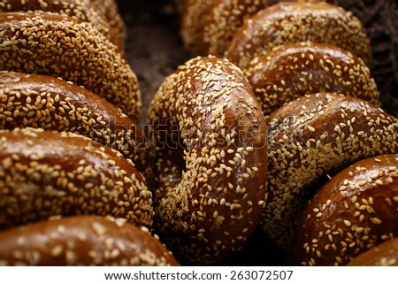 Basket full of  bagels with shallow dept of field - stock photo