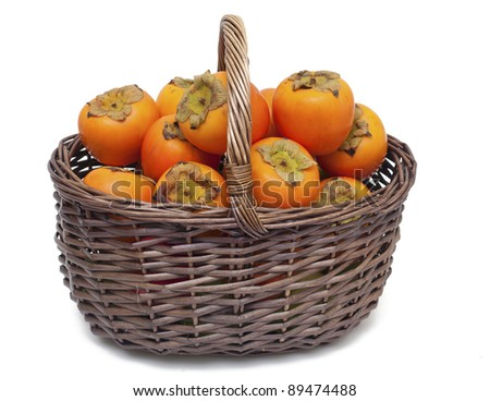 basket full of persimmons isolated on white background - stock photo