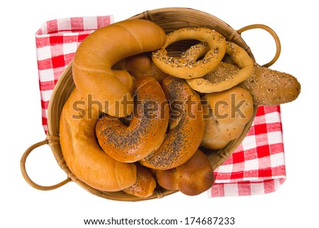 Basket full of rolls and buns isolated on white - stock photo