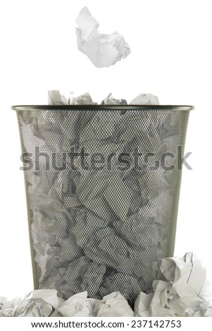 basket full of white wastepaper on white background - stock photo