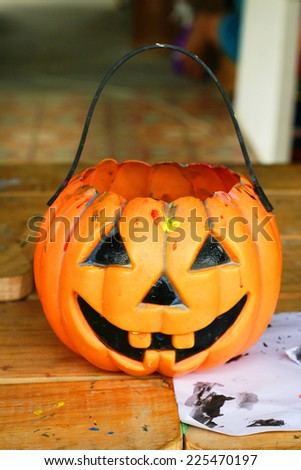 Basket in Jack-o'-lantern Halloween pumpkin or squash shape  - stock photo
