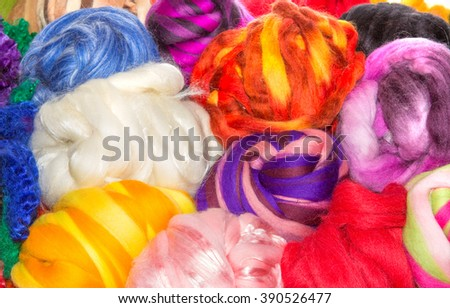 Basket of balls of bright natural wool balls - stock photo