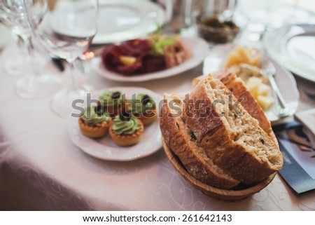 basket of bread on the table in a restaurant - stock photo