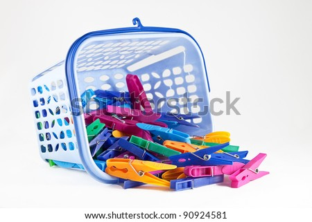 basket of clothespins - stock photo