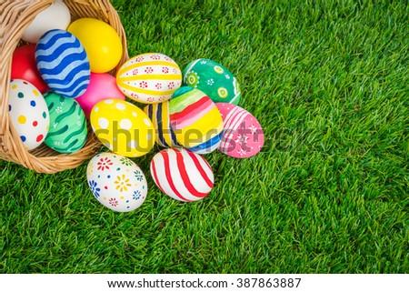 Basket of easter eggs  on Fresh Green Grass - stock photo