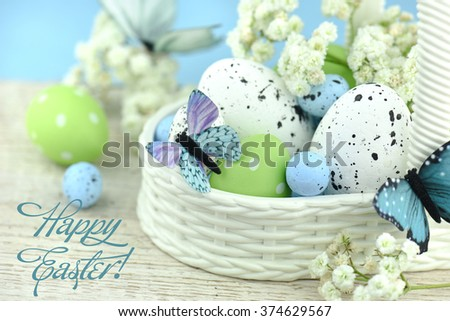 Basket of easter eggs with flowers. - stock photo