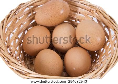basket of eggs isolated - stock photo