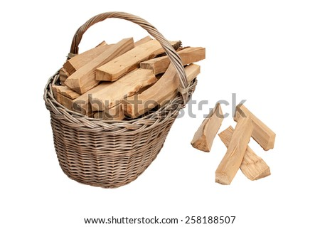 Basket of firewood - stock photo