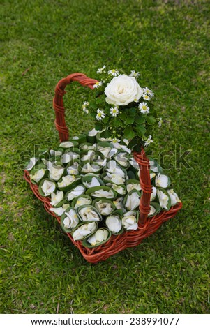 Basket of flower petals to throw at a wedding ceremony. - stock photo