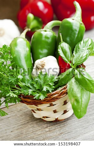 basket of fresh basil leaves with garlic and peppers - stock photo