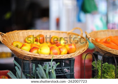 Basket of fresh bio apples on Paris farmer agricultural market - stock photo