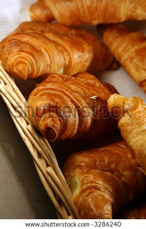 basket of Fresh croissant - stock photo