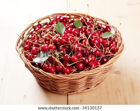 Basket of fresh red cherries - stock photo