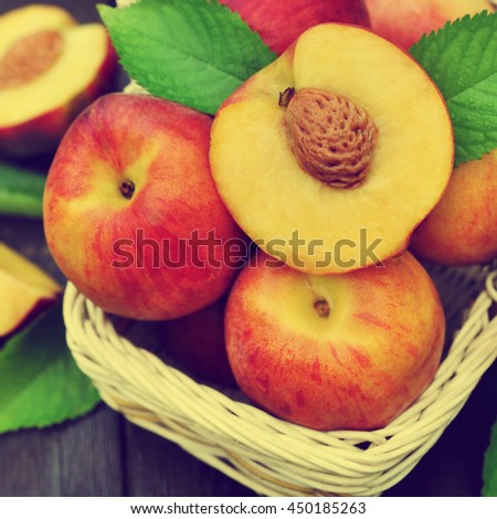 Basket of fresh ripe sweet peaches, selective focus, toned - stock photo