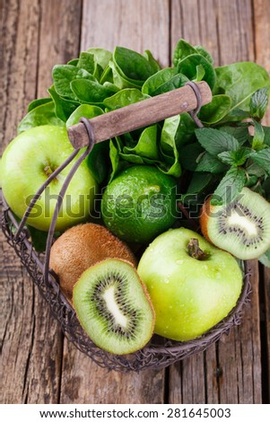 Basket of green fruit. Vitamin green set of kiwi,Apple, spinach, mint,lime.selective focus - stock photo