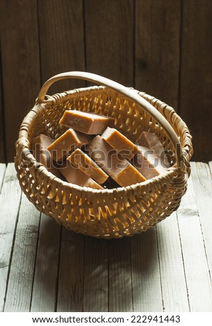 basket of marble pattern homemade soaps drying, old wooden background - stock photo