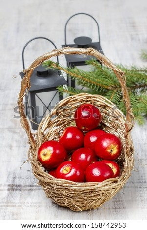 Basket of red apples on wooden table - stock photo