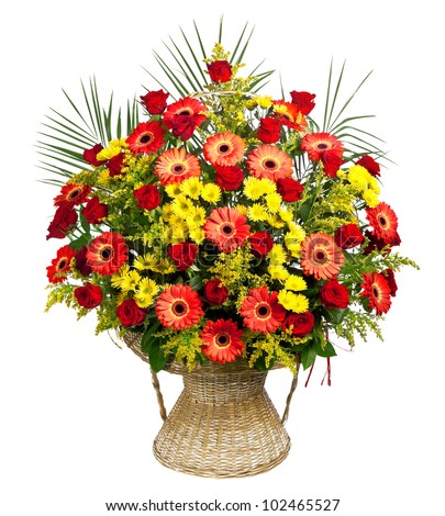 basket of roses, gerberas and palm leaves - stock photo
