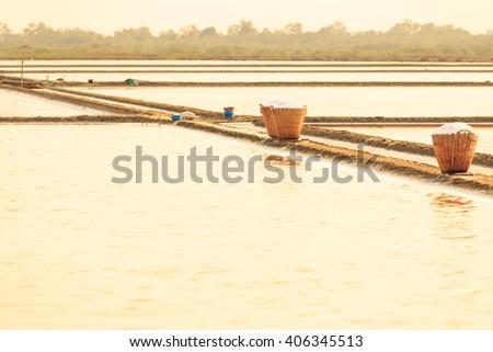 Basket of salt in the farm, Phetchaburi province,Thailand, in evening - stock photo