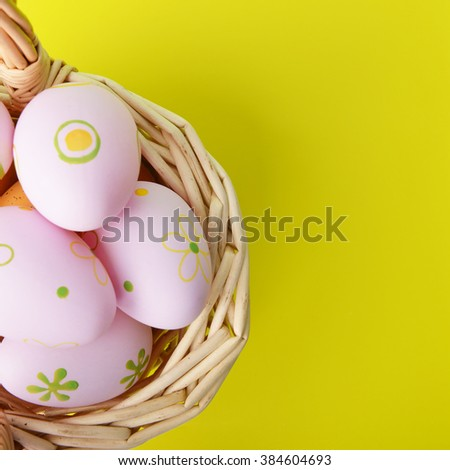 basket wicker with decoration easter eggs - stock photo