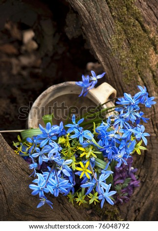 basket with a spring bouquet costs on a tree - stock photo