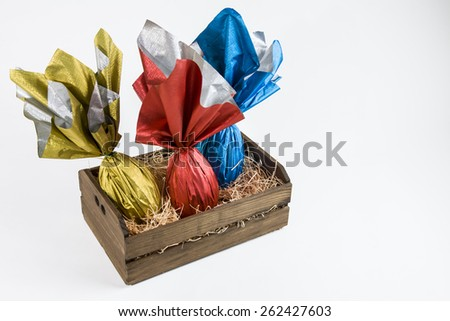 basket with Brazilian Easters eggs, on a white background. - stock photo
