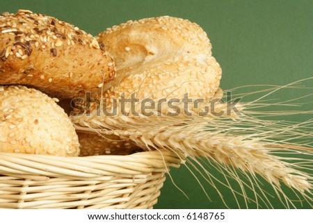 Basket with bread and wheat  in Thanksgiving - stock photo