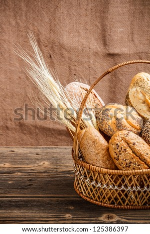 Basket with bread canvas in background - stock photo