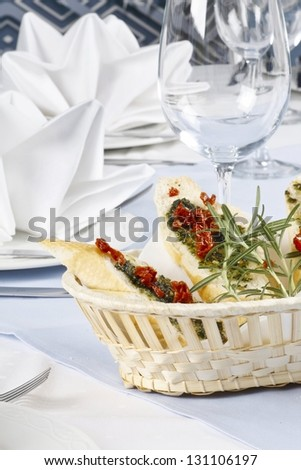 Basket with bruschetta on a table - stock photo