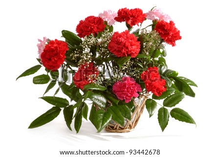 Basket with bunch of red carnations isolated on white background - stock photo