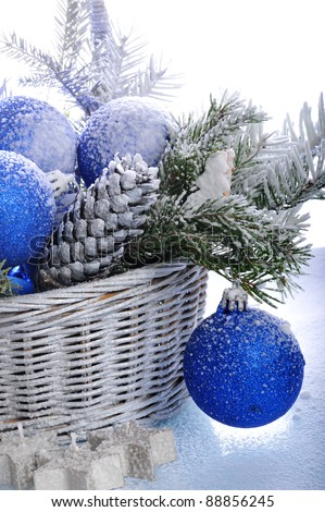 Basket with  christmas ornaments - stock photo