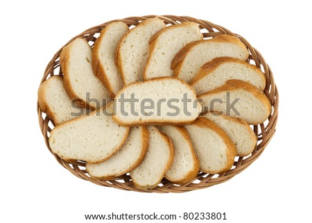 Basket with cut loaf of bread isolated on white background, top view \ Basket with Cut loaf of bread - stock photo