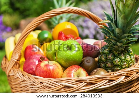 basket with different fruits - stock photo