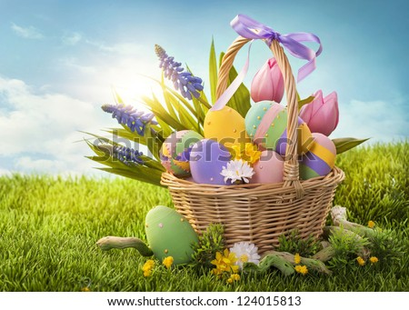 Basket with easter eggs  on green grass - stock photo