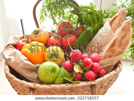 Basket with fresh produce from the farmers market - stock photo