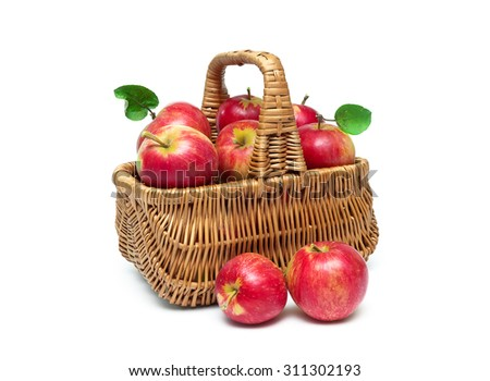 basket with ripe red apples close-up isolated on white background. horizontal photo. - stock photo