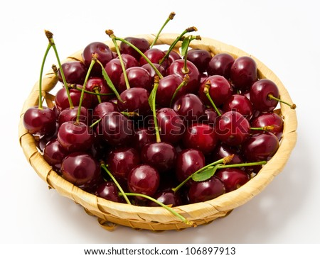 Basket with ripe wet cherry isolated on a white - stock photo
