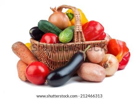 basket with vegetables isolated on white background - stock photo