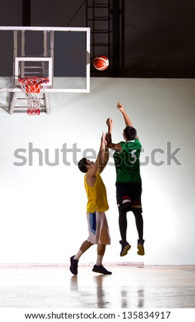 Basketbal player in the game - stock photo