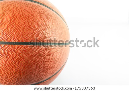 Basketball ball in a hand on white background - stock photo