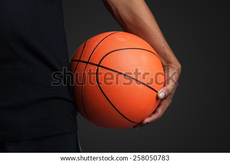 Basketball ball in hands  - stock photo