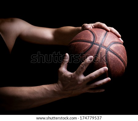 Basketball ball in the hands - stock photo