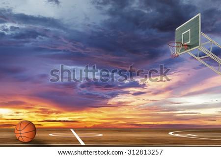 Basketball ball on outdoor basketball court - stock photo
