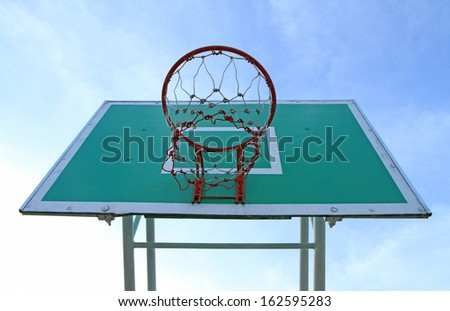 Basketball board against blue sky background - stock photo