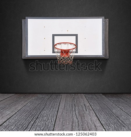 Basketball board on blackboard background with ground of the wood - stock photo