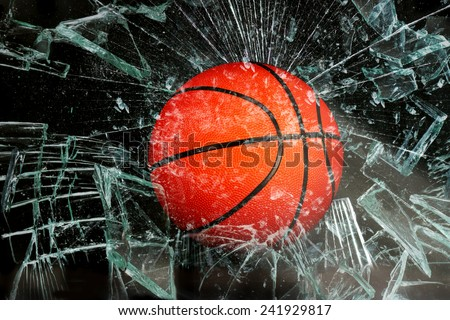 Basketball breaking glass. - stock photo