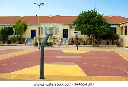 Basketball court in the backyard of the school. - stock photo