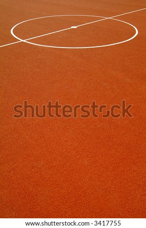 basketball court with a red rubber floor - stock photo