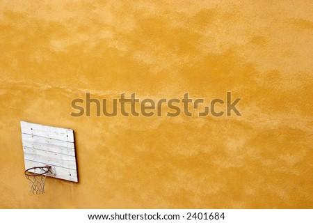 basketball court, yellow wall - stock photo