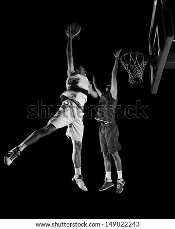 basketball game sport player in action isolated on black background - stock photo